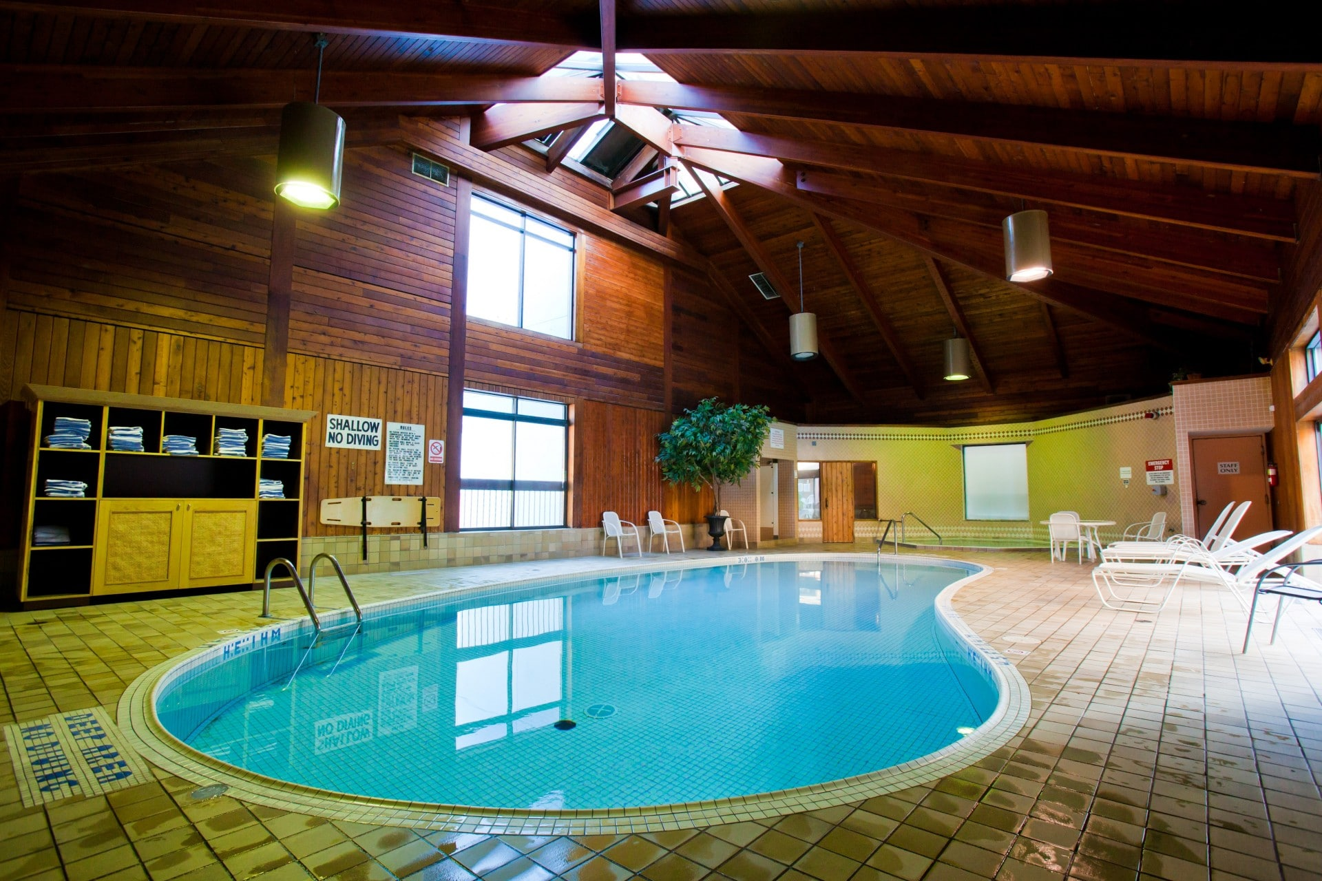 indoor pool with wooden celing