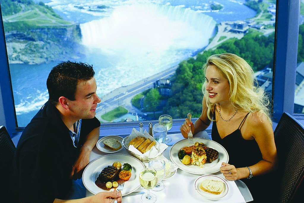 Couple eating dinner at the revolving dining room at Skylon Towers