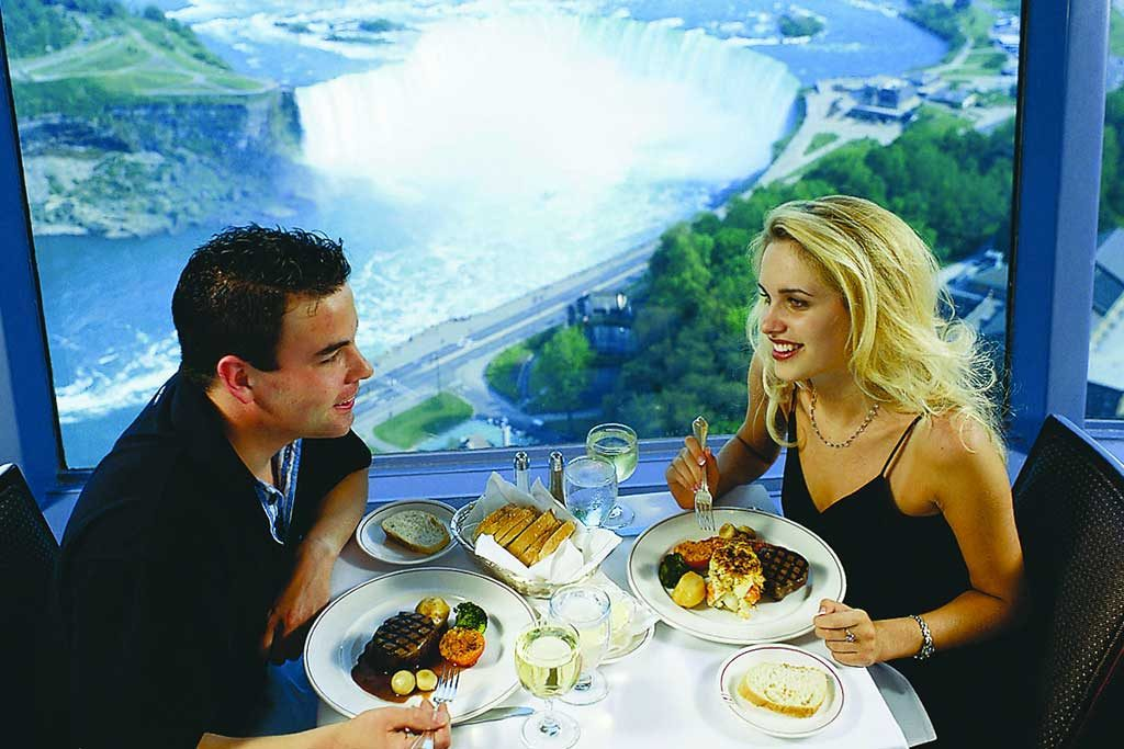 Couple eating dinner at the revolving dining room at Skylon Tower